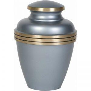 urne funéraire en laiton gris et or pour recueillir cendres du défunt dans la sobriété